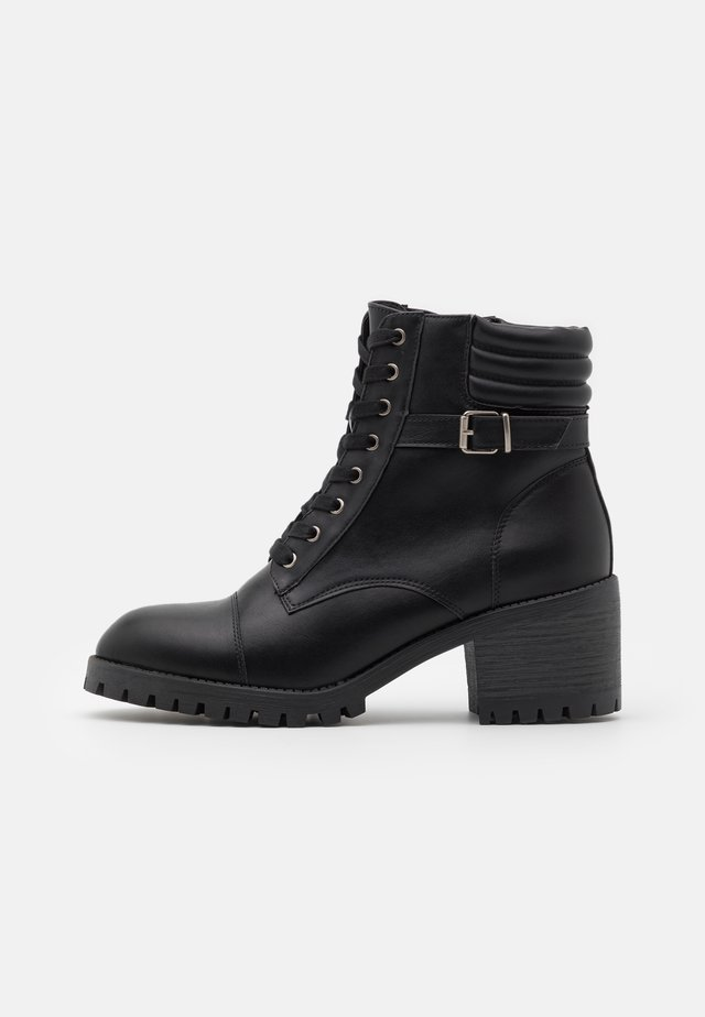 HARLEE - Lace-up ankle boots - black