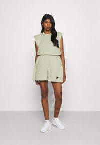 Nike Sportswear - TANK EARTH DAY - Camiseta estampada - olive aura/galactic jade - 1