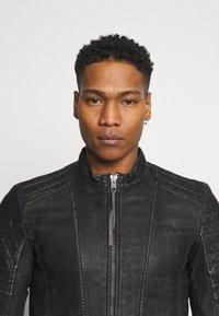 Tigha - CADAN - Leather jacket - black stone wash - 3