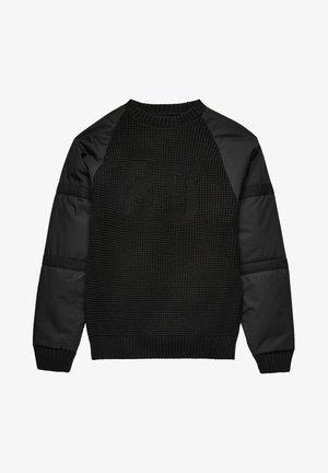 Stickad tröja - dk black