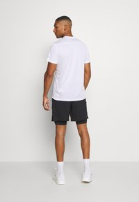 Under Armour - LAUNCH 2-IN-1 SHORT - kurze Sporthose - black - 2
