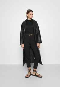 ONLY - ONLLENIA MARA CIGARETTE - Trousers - black - 1