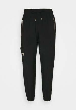 SOFT UTILITY - Tracksuit bottoms - black
