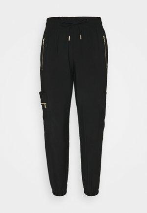 SOFT UTILITY - Pantalones deportivos - black