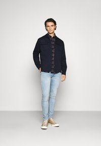 Levi's® - 519™ EXTREME SKINNY - Jeans Skinny Fit - spears adv - 1