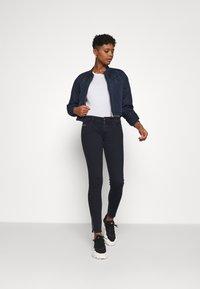 Diesel - SLANDY-LOW-ZIP - Jeans Skinny Fit - dark blue - 1