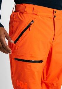 Helly Hansen - SOGN - Snow pants - bright orange - 4
