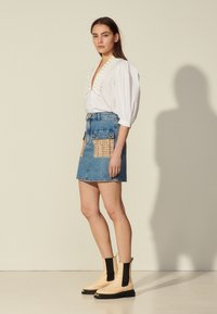 sandro - FIORINA - Mini skirt - bleu denim - 1