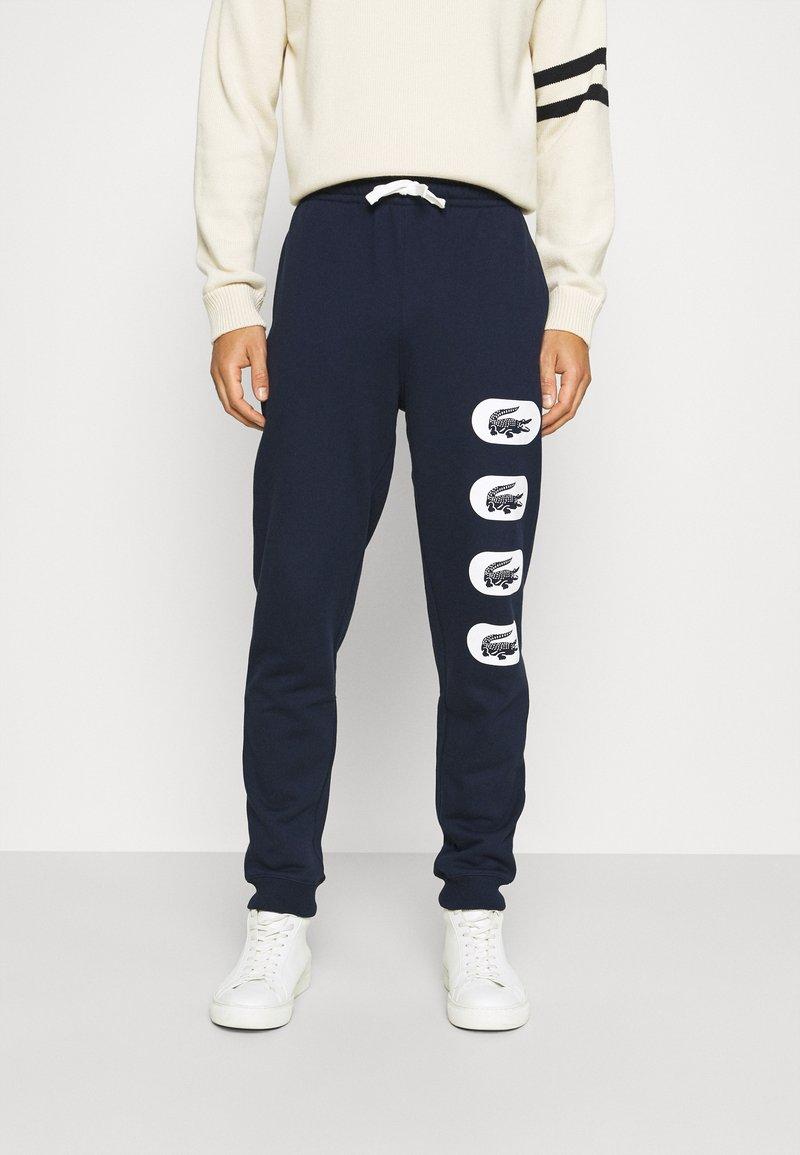 Lacoste - Tracksuit bottoms - navy blue