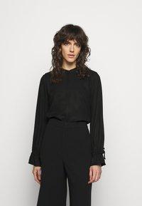 Bruuns Bazaar - PRALENZA MARIBEL - Blouse - black - 0