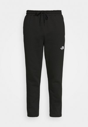 STANDARD PANT - Tracksuit bottoms - black