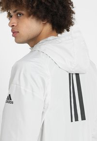 adidas Performance - URBAN - Cortaviento - raw white - 3
