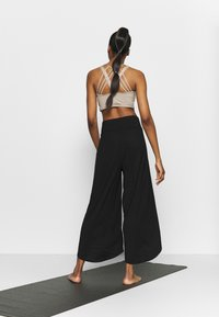 South Beach - WRAP SPLIT PANT - Pantalones deportivos - black - 2