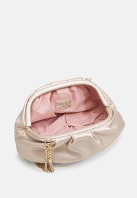 LIU JO - POCHETTE - Across body bag - light gold - 2