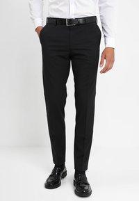 Tommy Hilfiger Tailored - Spodnie garniturowe - black - 0