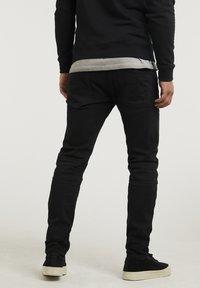CHASIN' - NISON - Slim fit jeans - black - 1