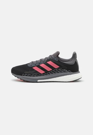 SOLAR GLIDE BOOST RUNNING SHOES - Neutrala löparskor - core black/signal pink/copper metallic