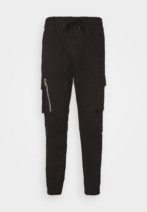 DIVIDE - Cargo trousers - black