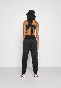 Nike Sportswear - AIR - Tracksuit bottoms - black/white - 2