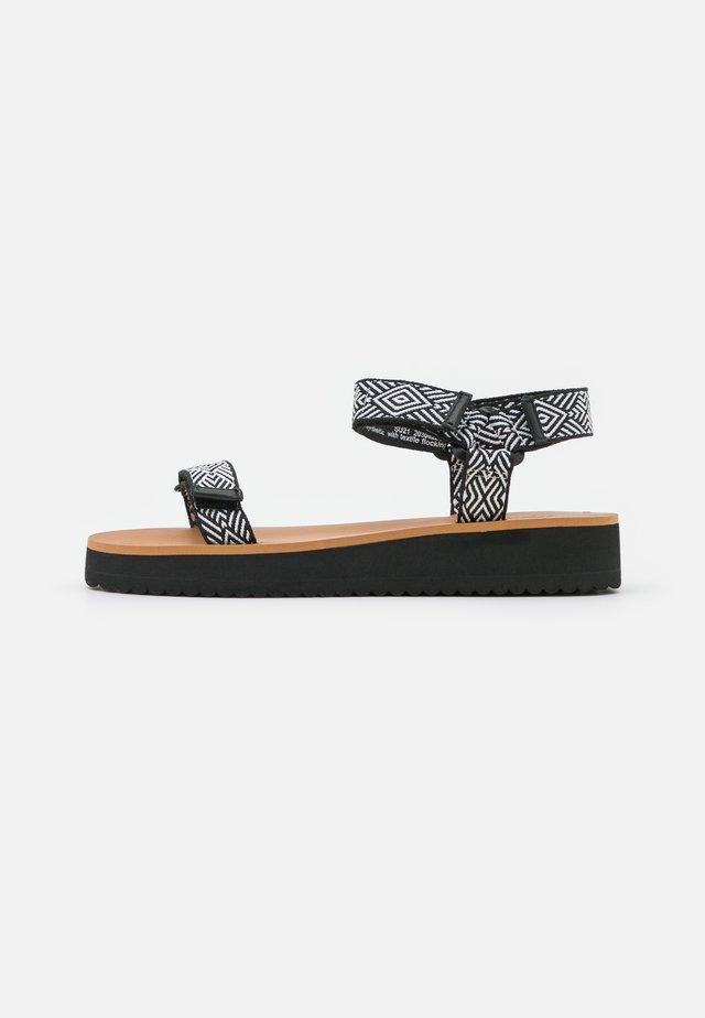 MAGGIE - Platform sandals - true black/multicolor