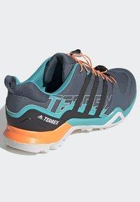 adidas Performance - TERREX SWIFT R2 HIKING SHOES - Hiking shoes - green - 4