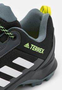 adidas Performance - TERREX AX3 - Hiking shoes - core black/footwear white/acid yellow - 5