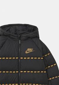 Nike Sportswear - UNISEX - Light jacket - black/metallic gold - 2