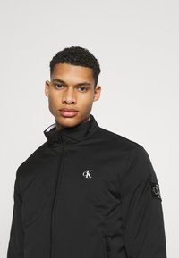 Calvin Klein Jeans - HARRINGTON PADDED JACKET - Light jacket - black - 3