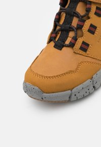 Geox - FLEXYPER BOY ABX - Classic ankle boots - dark yellow/black - 5