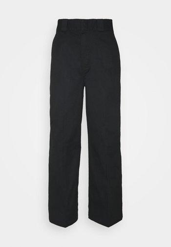 WINNSBORO - Trousers - black
