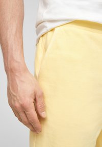 s.Oliver - Tracksuit bottoms - yellow - 4