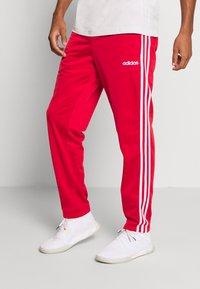 adidas Performance - 3 STRIPES SPORTS REGULAR PANTS - Teplákové kalhoty - scarlett/white - 0