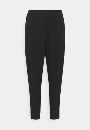 TRAIN PANT - Pantalones deportivos - black