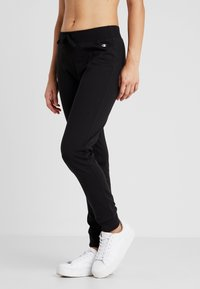 Champion - CUFF PANTS - Tracksuit bottoms - black - 0