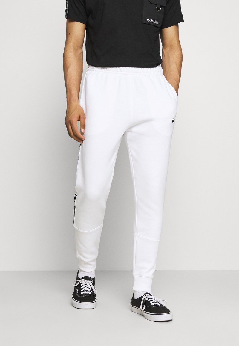 Nike Sportswear - REPEAT - Tracksuit bottoms - white/black