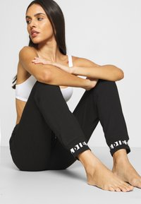 Diesel - UFLB ALINA TROUSERS - Pyjama bottoms - black - 3