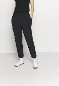 Nike Performance - PANT - Tracksuit bottoms - black/silver - 0