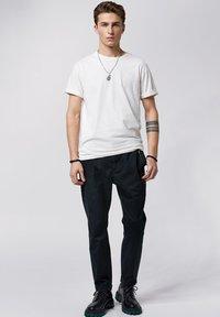 Tigha - Trousers - vintage black - 1