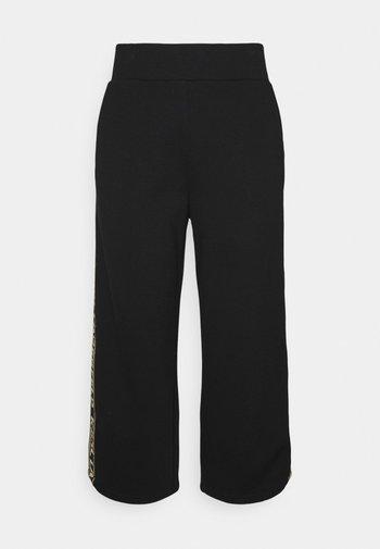LOGO TAPE PANTS - Trousers - black/gold