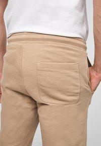s.Oliver - Tracksuit bottoms - brown - 4