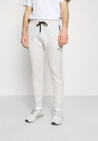 Hollister Co. - ICONIC PRINT - Tracksuit bottoms - texture grey - 0