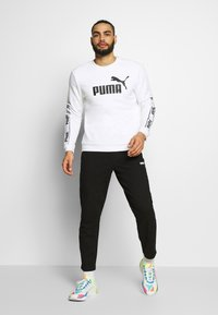 Puma - Tracksuit bottoms - black - 1