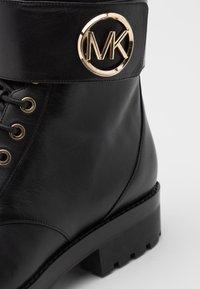 MICHAEL Michael Kors - TATUM BOOT  - Lace-up ankle boots - black - 4
