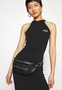 Puma - BODYCON DRESS - Shift dress - black - 3