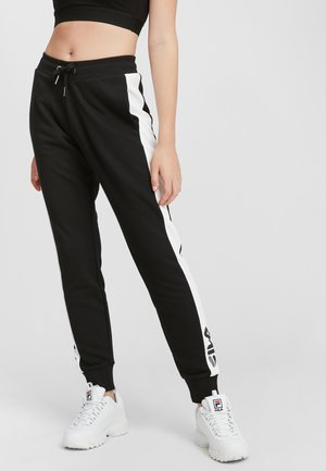 FREYA  - Tracksuit bottoms - black-bright white