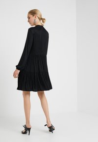 Steffen Schraut - THE  GLAM DRESS - Sukienka z dżerseju - black - 2