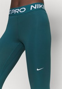 Nike Performance - Leggings - petrol blue - 4