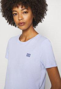 Tommy Hilfiger - CINDY REGULAR - Basic T-shirt - polished blue - 4