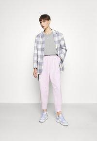 Nike Sportswear - Tracksuit bottoms - pink foam - 1