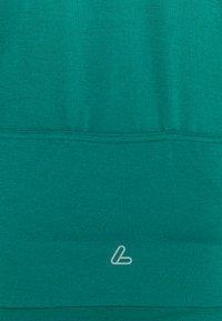 LÖFFLER - BIKE PACE - Training jacket - lagoon - 2
